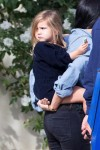 Penelope Disick gets a piggy back ride after a lunch at Lovi's with her mom Kourtney & dad Scott