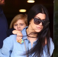 Penelope Disick gets a piggy back ride after a lunch at Lovi's with her mom Kourtney & dad Scott t