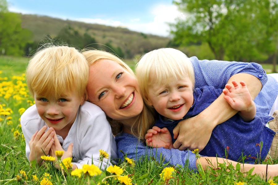 Happy Mother And Children Playing Outside Growing Your Baby