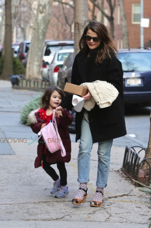 Pregnant Keri Russell arrives home with her daughter Willa Dreary