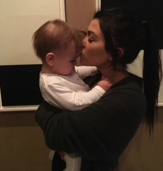 kourtney Kardashian shares a photo of her and her son Reign at midnight