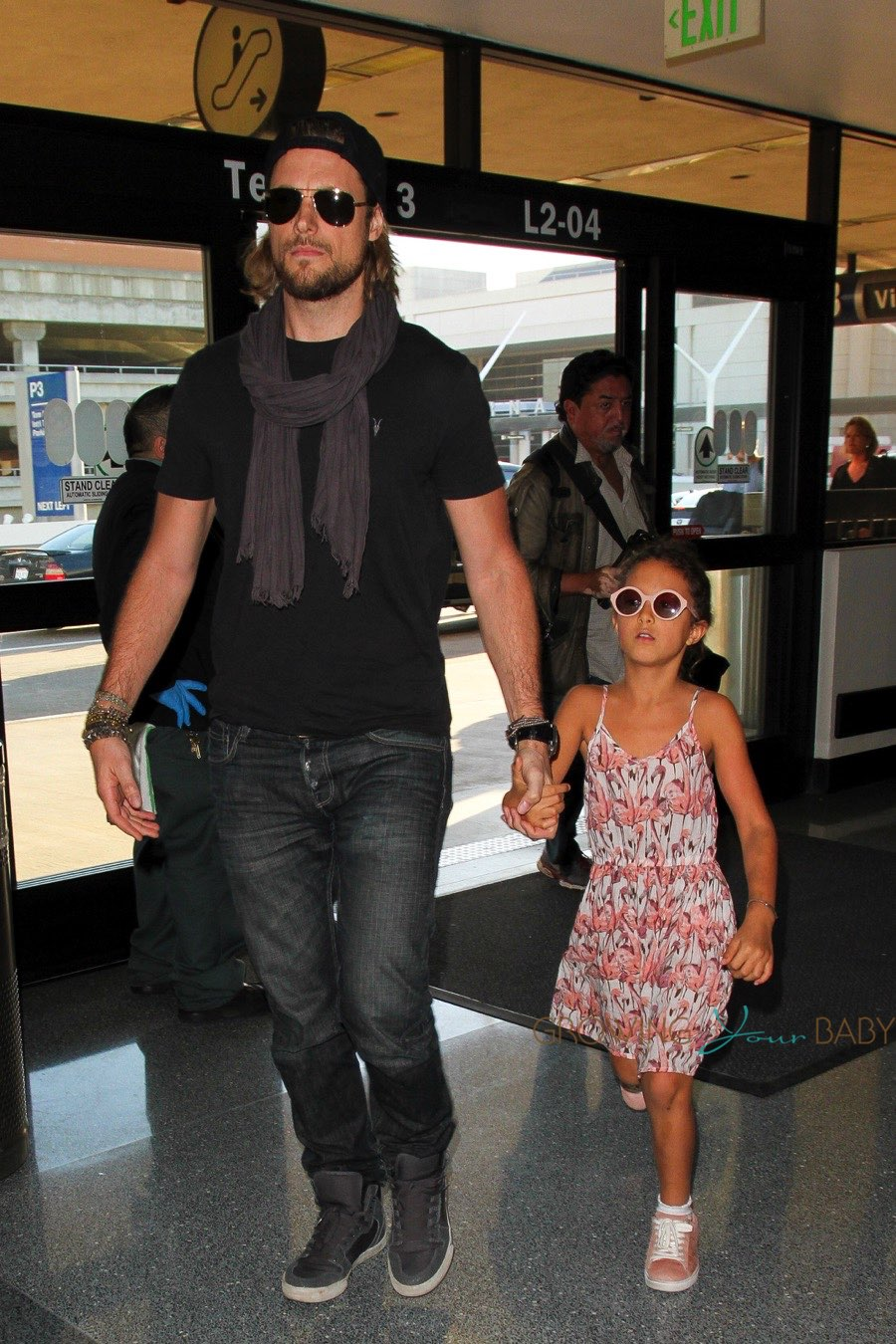 Gabriel Aubry Arrives At Lax With Daughter Nahla