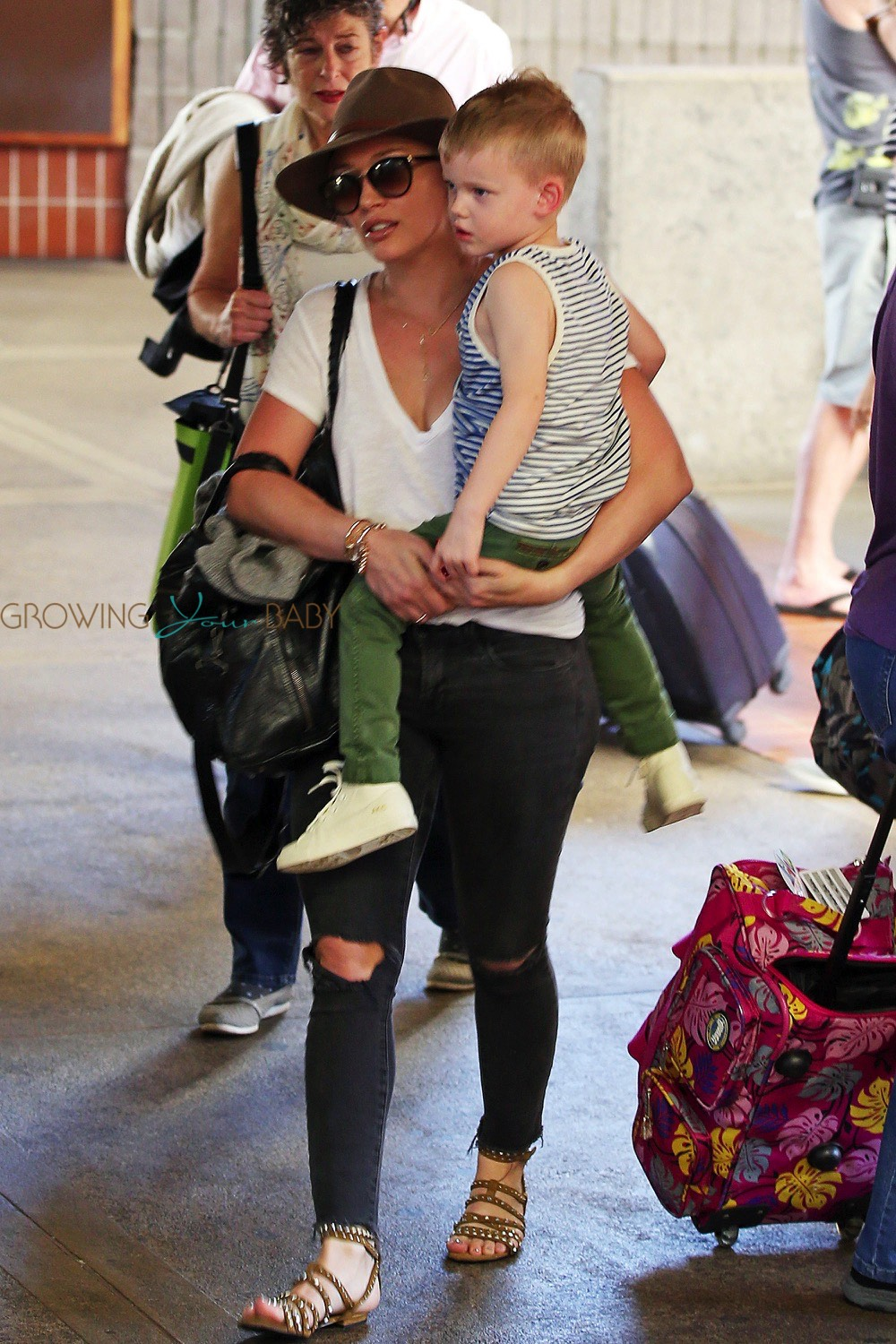 Hilary Duff Is Spotted At The Airport In Maui With Her Son Luca Comrie On February