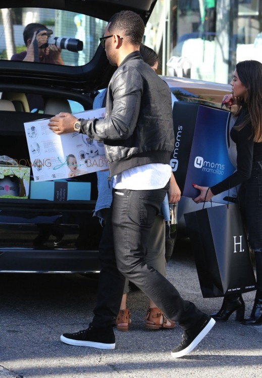 John Legend loads baby gear into the car after shopping with Kim and Kanye