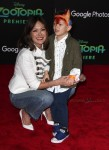 Lindsay Price walks the red carpet at the zootopia premiere