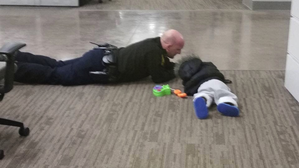 Ohio Officer Will Nastold comforts a toddler that was found wandering the streets