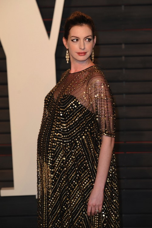 Pregnant Anne Hathaway on the red carpet at the Vanity Fair Party 2016