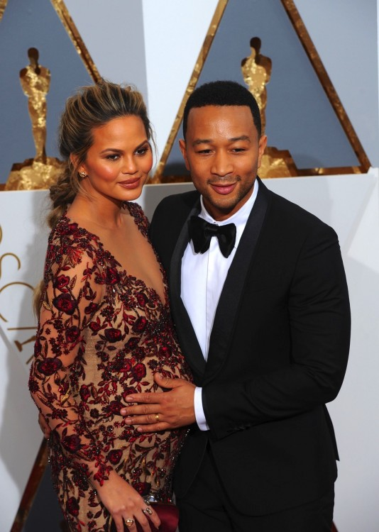 Pregnant Chrissy Teigen and husband John Legend at the 88th Annual Academy Awards
