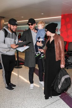 Pregnant Ginnifer Goodwin & Josh Dallas depart LAX with their Son Oliver
