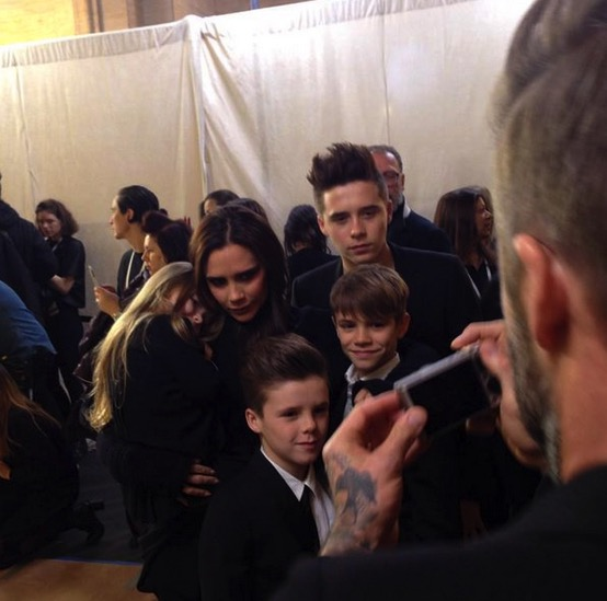 Victoria Beckham is surrounded by her children at her fashion show