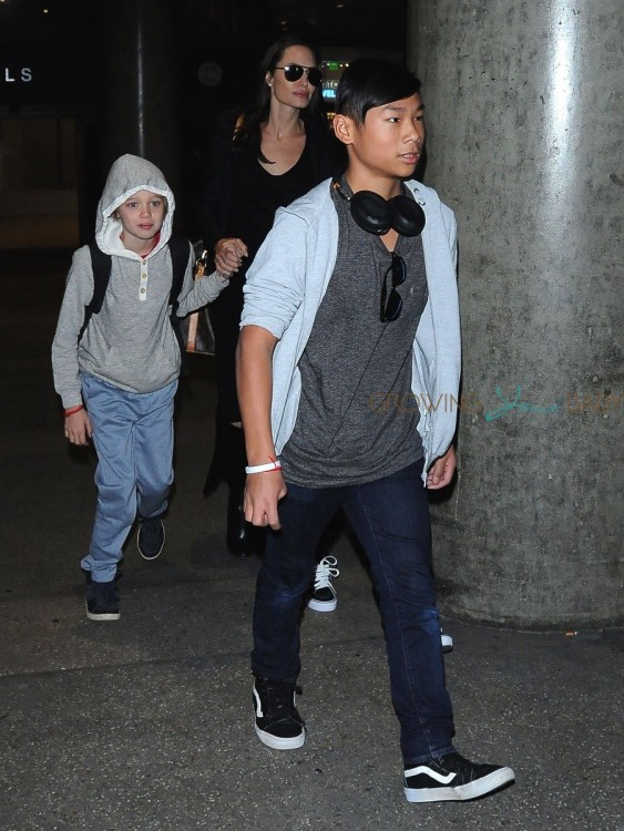 Angelina Jolie and her kids Pax, Shiloh & Zahara are spotted arriving on a flight at LAX airport