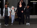 Angelina Jolie and her kids Pax, Shiloh and Zahara are spotted arriving on a flight at LAX airport