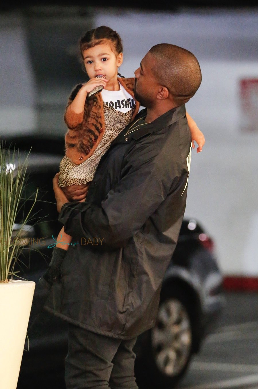 baac45bd98877 Kanye West Carries his daughter North West as they head in to the mall
