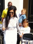 Kourtney Kardashian and Mason Disick attend Easter Sunday with mom Kris Jenner and son Reign