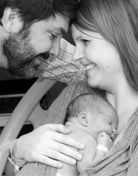 Megan and David Whaley, with their daughter, Emery, who was born during an unplanned home birth