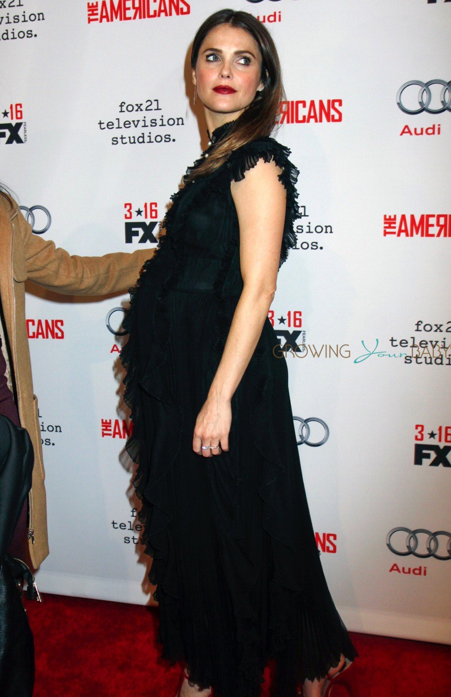 Mom-to-be Keri Russell walks the red carpet for the premiere of 'The Americans