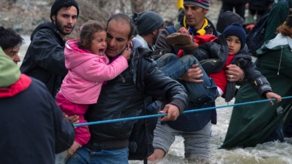 Syrians crossing river