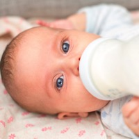 baby drinking a bottle t