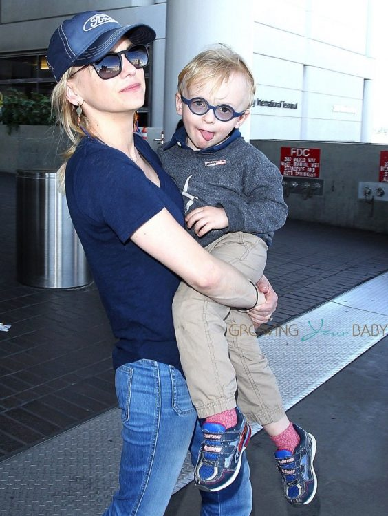 Anna Faris & Son Jack Arriving On A Flight At LAX
