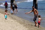 Brian Austin Green with sons Noah and Bodhi at the beach in Malibu