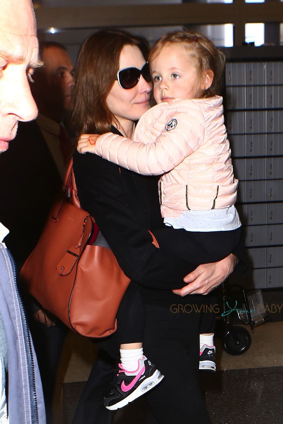 Carla Bruni Departs Lax With Her Daughter
