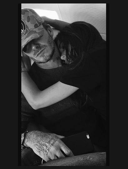 David and Victoria Beckham airplane cuddle