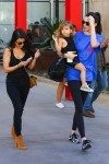 Kendall Jenner carries niece Penelope after a trip to the LCMA