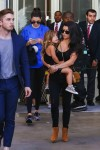 Kourtney Kardashian carries daughter Penelope after a trip to the LCMA