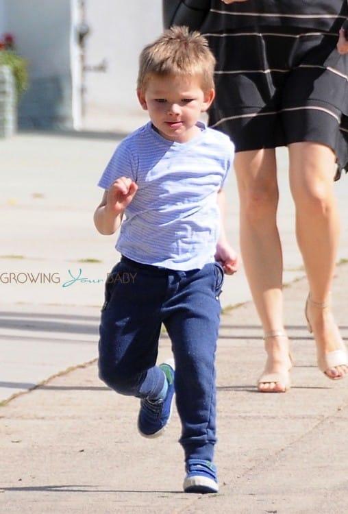 Samuel Affleck runs to meet his sisters after leaving church