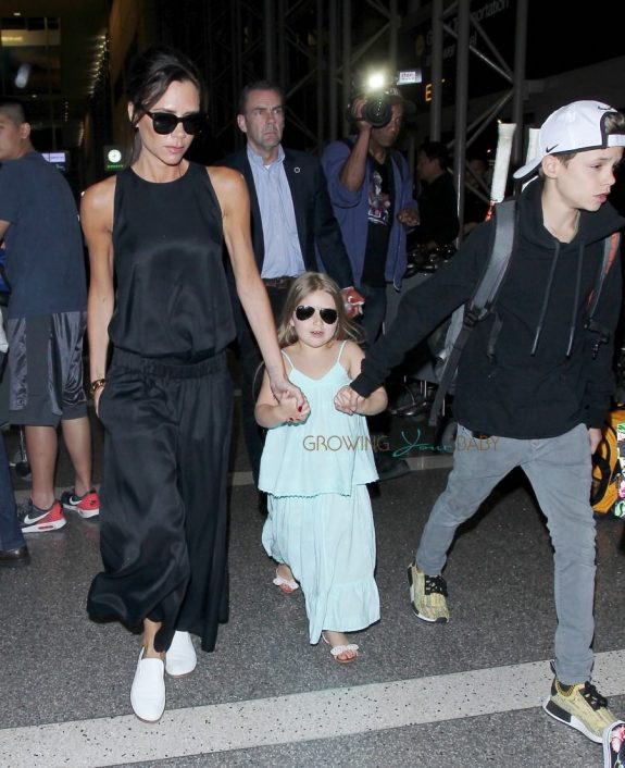 Victoria Beckham at the airport with kids Harper, Cruz and Romeo