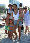 KOurtney Kardashian at the beach in Miami with kids Penelope Mason and Reign Disick
