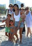 KOurtney Kardashian at the beach in Miami with kids Penelope Mason and Reign Disick