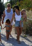 KOurtney Kardashian at the beach in Miami with kids Penelope and Reign Disick