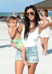 KOurtney Kardashian at the beach in Miami with son Reign Disick
