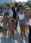 Kourtney Kardashian at the beach in Miami with kids Mason, Penelope and Reign Disick