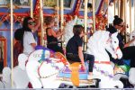 Kourtney kardashian rides the carousel with kids mason and Penelope