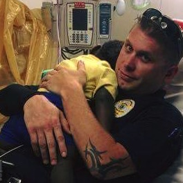 Police Officer Comforts Toddler Alone in Hospital