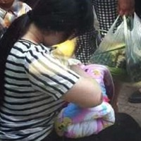 Woman Breastfeeds Abandoned Baby