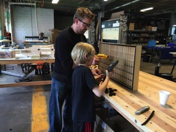 Lars and his dad building the cabinets