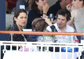 Marion Cotillard and son Marcel with partner Guillaume Canet at the Longines Athina Onasis tournament