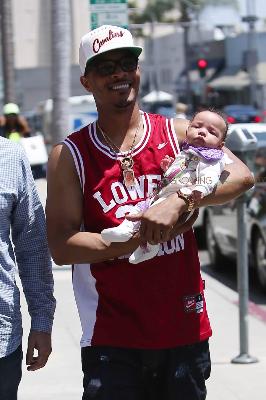 T I Cradles His Beverly Hills Baby Growing Your Baby