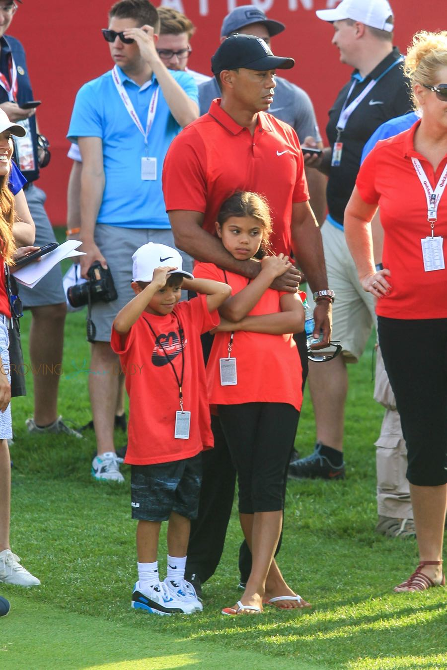 Tiger Woods attends the Quicken Loans National PGA Golf Tournament with his daughter Sam and son Charlie