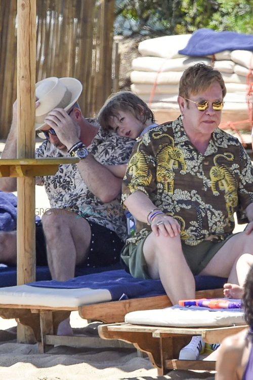Elton John and David Furnish relax on the beach with their boys in Sardinia