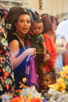 Kim Kardashian with kids North and Saint at grandmother's store opening San Diego
