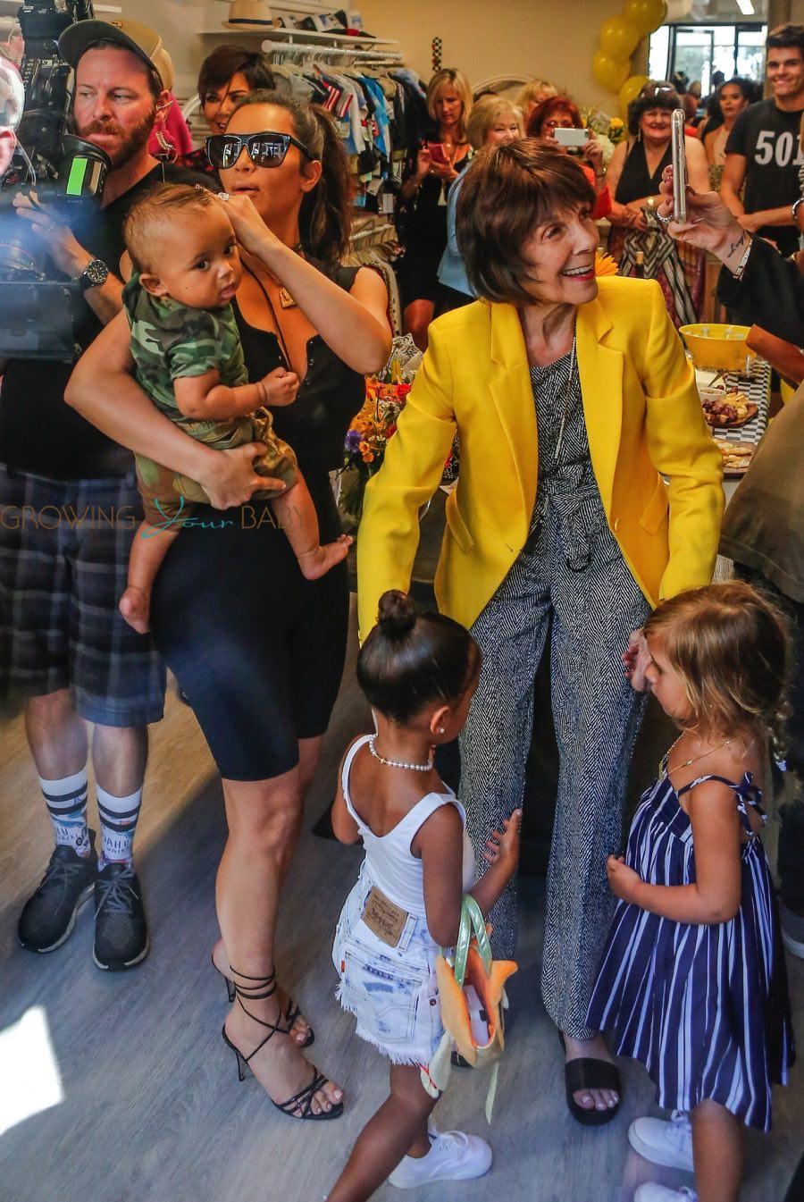 Kim Kardashian with kids North and Saint at grandmother's store