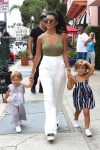 Kourtney Kardashian with kids Penelope and Reign at grandmother's store opening in San Diego