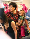 Kris Jenner carries grandson Saint West at her mother's store opening in San Diego