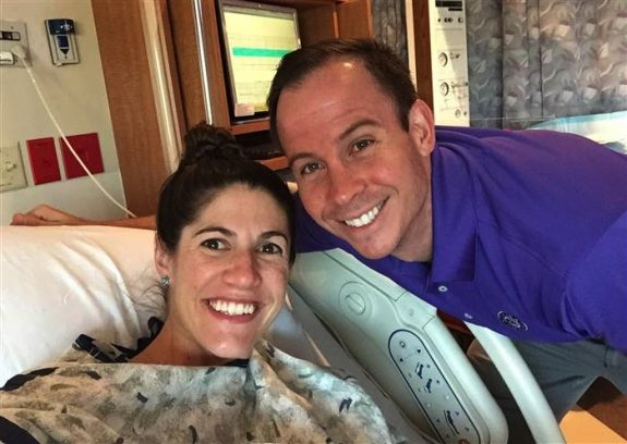 Leah and her husband, Kyle, after their son was born
