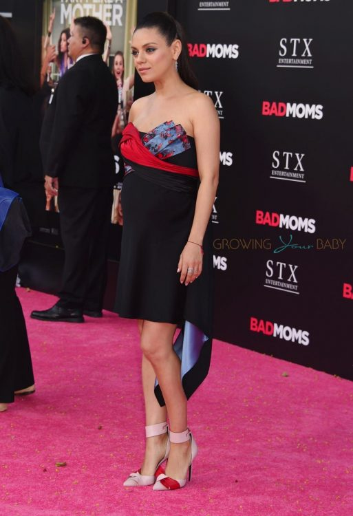 Mila Kunis walks the red carpet at the 'Bad Moms' LA Premiere