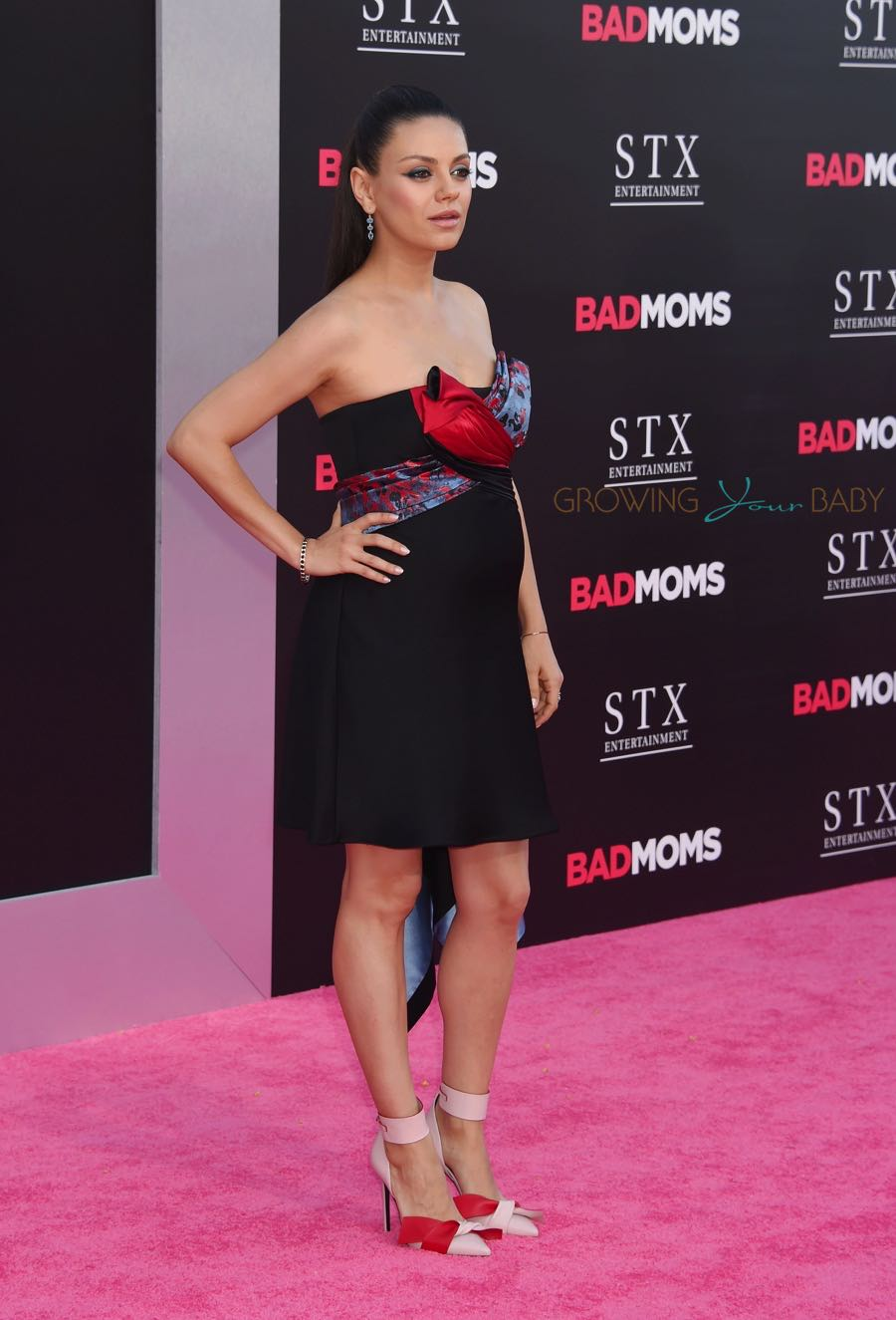 Pregnant Mila Kunis walks the red carpet at the  'Bad Moms' LA Premiere